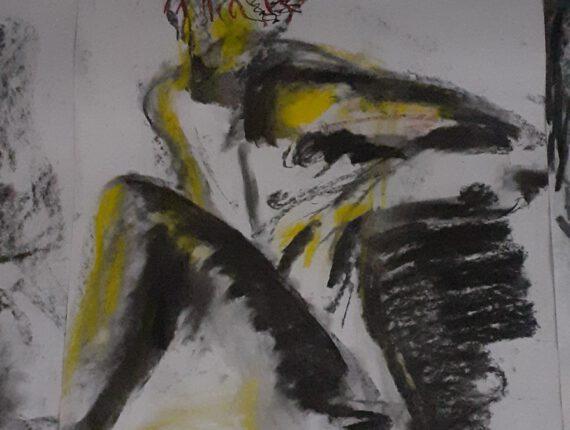 man met geel